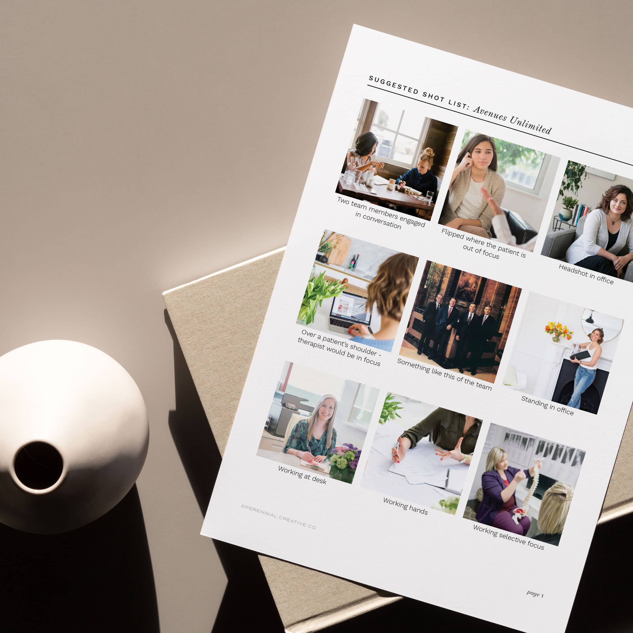 Avenues Unlimited shot list with 9 photos laying on top of a book next to a vase